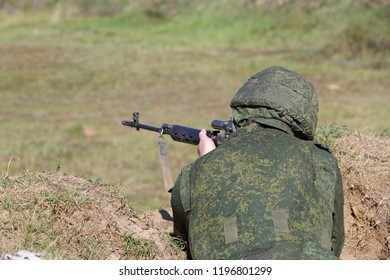 The sniper shoots out of the trench
