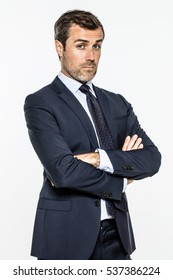 snob middle aged businessman with arms crossed standing, posing with arrogance or mocking questions, white background studio