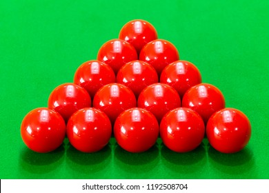 Snooker balls set on a green table.