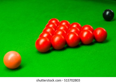 snooker balls set on a green table, billiards game