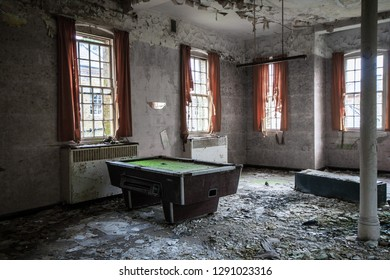 Snooker table at an abandoned and derelict lunatic asylum/hospital (now demolished), Cane Hill, Coulsdon, Surrey, England, UK