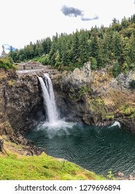 Snoqualmie Falls is a 268-foot (82 m) waterfall in the northwest United States, located east of Seattle on the Snoqualmie River between Snoqualmie and Fall City, Washington.
