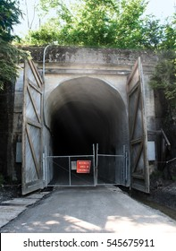 "The Snoqualmie Pass Railroad Tunnel with ""Tunnel Closed"" sign, with mist wafting out of the 2.5-mile long tunnel, built in 1912, which is now open to the public, near Snoqualmie Pass, Washington."