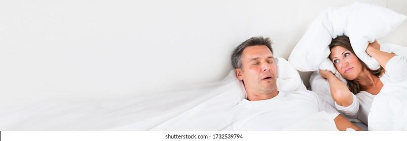 Snoring Man Sleeping With Apnea And Sleepless Woman