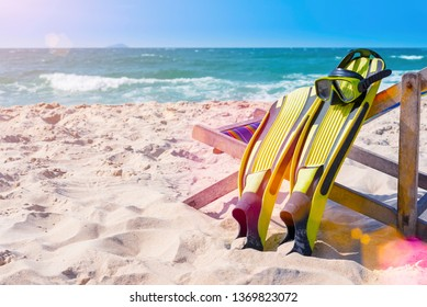 Snorkel and fin on the beach with sunlight. Summer and travel concept.