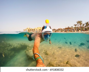 Snorkel swim in underwater exotic tropics paradise with fish and coral reef, beautiful view of tropical sea. Marsa alam, Egypt. Summer holiday vacation concept