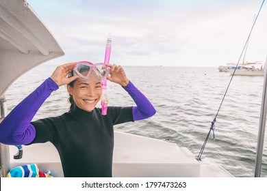 Snorkel watersport Asian woman tourist putting on mask for snorkeling activity in Miami, Florida, USA. Summer travel vacation.