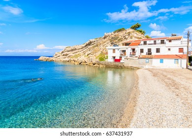 Snorkeler swimming in crystal clear azure sea water in Kokkari bay on sunny summer day, Samos island, Greece