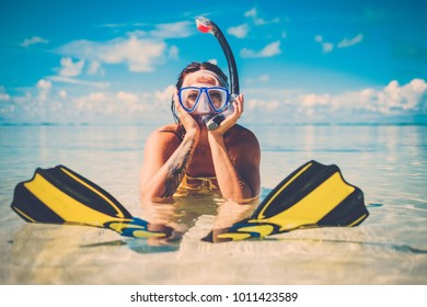 Snorkeler woman having fun on the tropical beach.