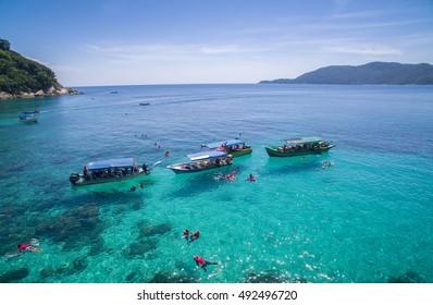 snorkeling group in clear water at perhentian island, terengganu malaysia