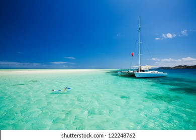 Snorkeling in shallow tropical water off the catamaran