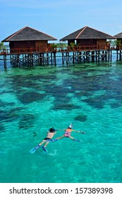 Snorkeling tourist Living in the ocean at Mabul island, Malaysia