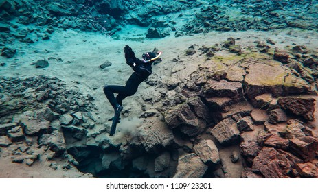 Snorkeling underwater in Iceland cold glacial water in a famous fissure Silfra between two tectonic plates