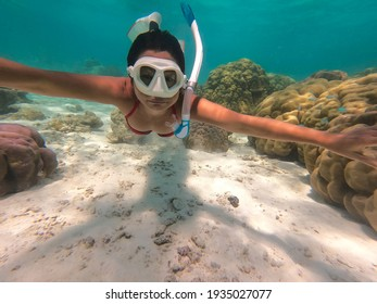 Snorkeling young woman exploring with  the tropical sea background, while Water sport outdoor activities. Swimming and snorkeling on summer holidays