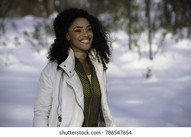 Snow against close up of a beautiful young black woman
