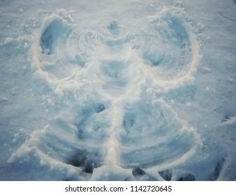 Snow angel on a fresh snow
