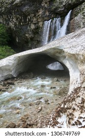 Snow arch in spring at the Gegsky waterfall in the mountains of Abkhazia