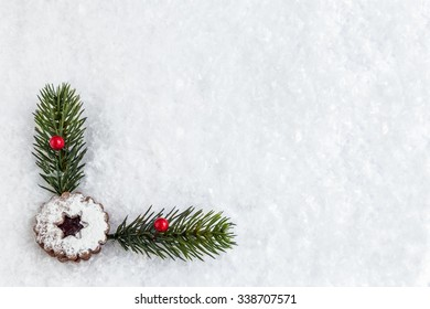 Snow background with christmas cookie and decoration.