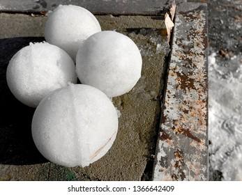 Snow balls on the ground.