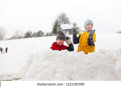 snow battle in the fortress. children throw snowballs in the park