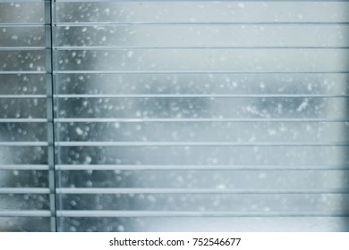 Snow Behind Windows