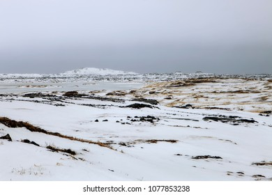 Snow blankets the rocky terrain on the Reykjanes Pennisula in Iceland