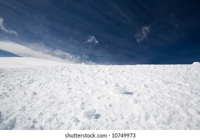 Snow and blue sky with clouds