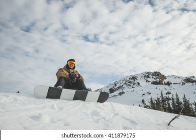 Snow boarder at Whistler resort in Canada