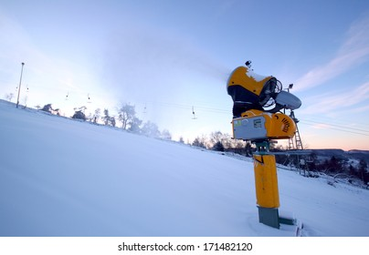 snow cannon and ski lift