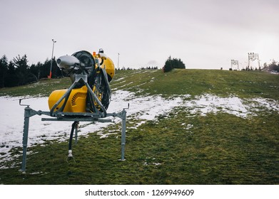 snow cannons running out of water during a dry winter on green piste