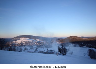 snow cannons at willingen in evening light