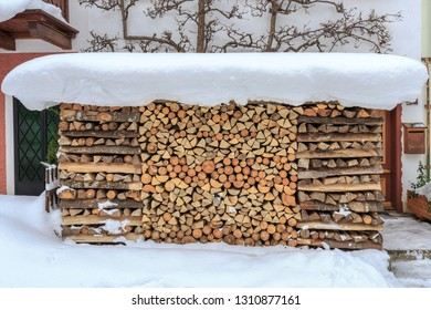 Snow capped firewood