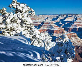 Snow capped Grand Canyon at sunrise