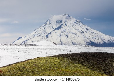 Snow- capped Mount Bolshaya Udina, volcanic massive, one of the volcanic complex on the Kamchatka Peninsula in the far east of Russia.