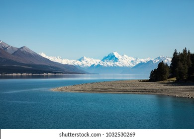 Snow capped Mount Cook set against the blue waters of Lake Taupo, New Zealand