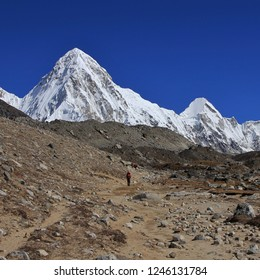 Snow capped mount Pumori and azure blue sky. Landscape near the Everest base camp. Trekking trail.