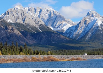 Snow capped Mount Wintour and Kananaskis lower lake in fall Alberta Canada