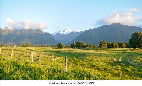 Snow capped mountain and farm in New Zealand