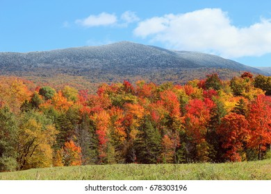 Snow capped mountains with beautiful fall foliage. Green Mountains in Vermont.