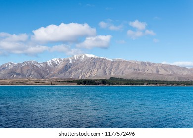 snow capped Mountains and blue Lake Tekapo