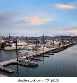 Snow Capped Mountains And Boats Under A Beautiful Morning Sky, In Harbor At Homer Alaska, Kenai Peninsula, USA