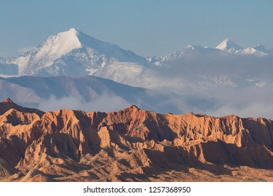Snow capped mountains and geological formations in the Issyk Kul Lake area, Kyrgyzstan