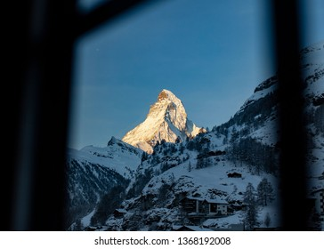 Snow capped peak of the famous Matterhorn of the Swiss Alps seen from a window in the morning