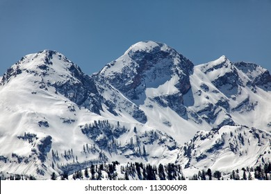 The snow capped peaks of Twin Peaks of the Wasatch mountains in Utah under clear blue sky's/ Snow Capped Wasatch Mountains