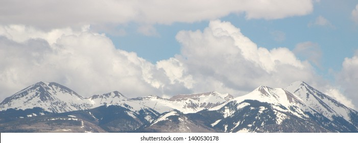 Snow Capped Peaks under a Cloudy Sky East of Moab, UT in Spring, Moab, UT (May 17, 2019)