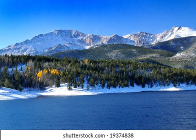 Snow capped Pikes Peak at Crystal Reservoir with a touch of golden aspen trees