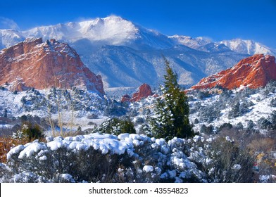 Snow capped Pikes Peak soaring over the Garden of the Gods Park after a fresh snowfall