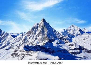 snow capped rocky mountain under clear blue sky during daytime