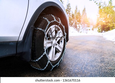 Snow chains on the wheels of the car,on Snowy weather .