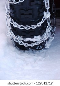 Snow chains outside at a wheel in winter
